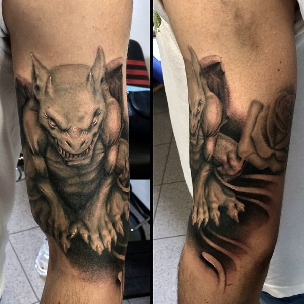 3D style very detailed biceps tattoo of gargoyle statue with rose