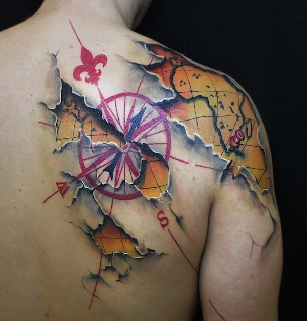 3D like nautical themed under skin shoulder and back tattoo of world map and compass