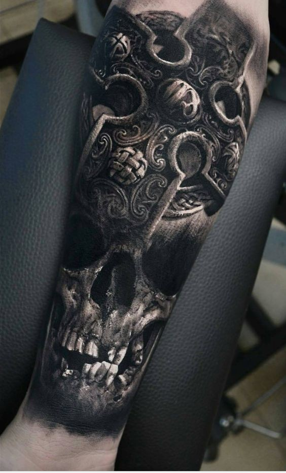 3D style very detailed forearm tattoo of old human skull with ancient cross