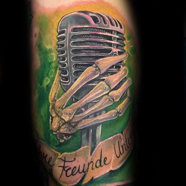 3D style very detailed tattoo of vintage microphone with skeleton hand and lettering