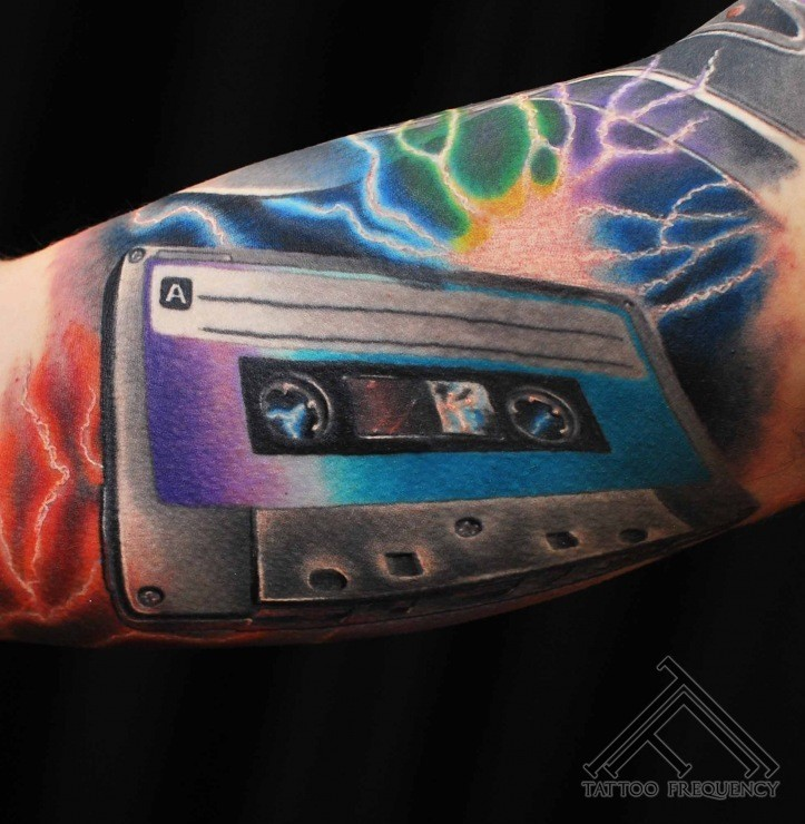 3D very realistic multicolored music tape tattoo on arm