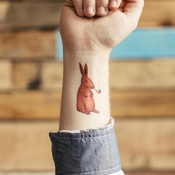 Amuse cartoon orange hare with tobacco pipe tattoo on wrist