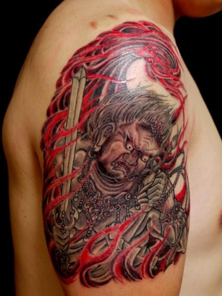 Asian traditional style colored upper arm tattoo of monster warrior with flames