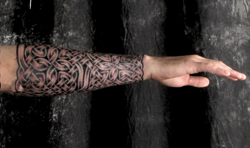 Awesome celtic gauntlet tattoo sleeve for men on forearm
