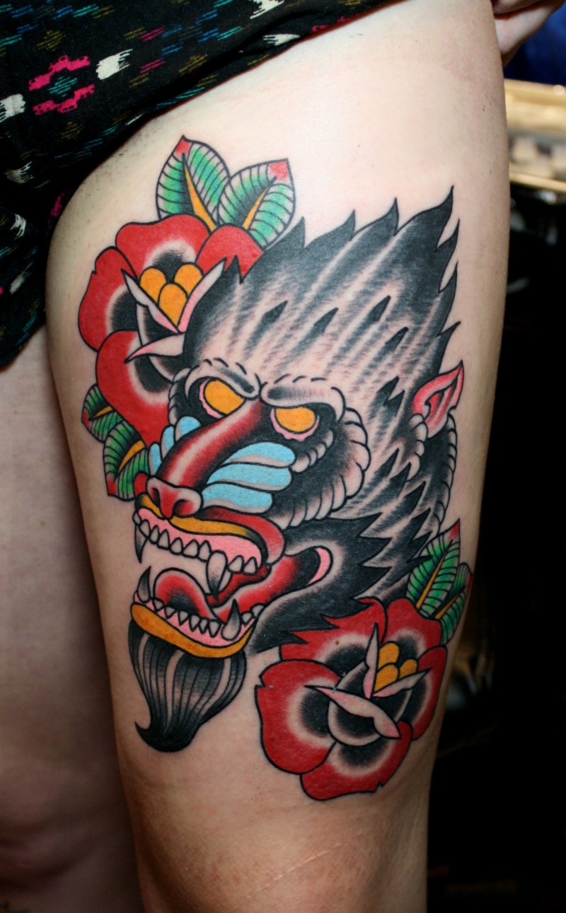 Awesome old school baboon with flowers tattoo on thigh