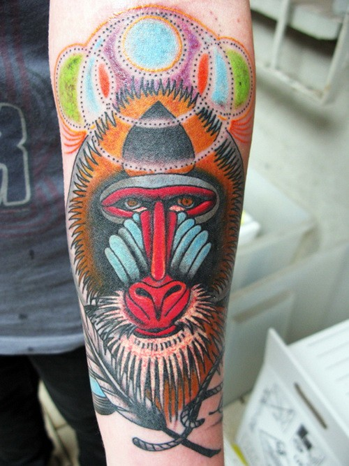 Beautiful calm baboon head tattoo on arm