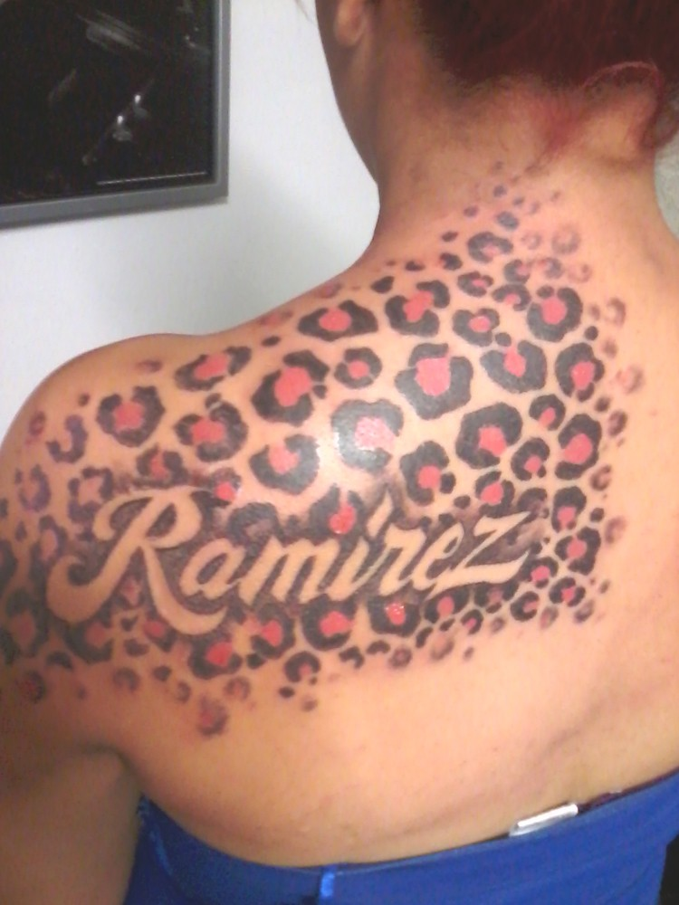 Beautiful color-ink cheetah print tattoo on shoulder
