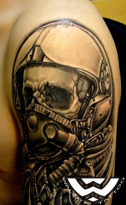 Black ink detailed modern pilon skull tattoo on upper arm