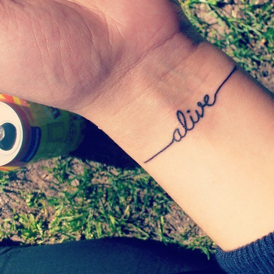 Brief heartbeat alive quote tattoo on arm