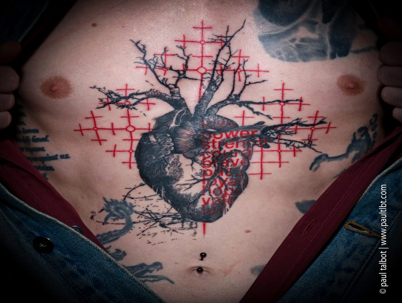 Colored trash polka style colored chest tattoo of heart with lettering
