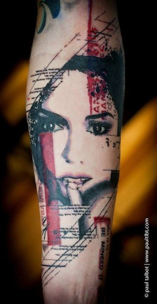 Colored trash polka style forearm tattoo of seductive woman with lettering