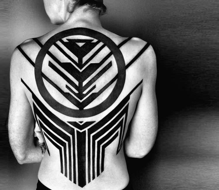 Cool geometrical back tattoo by ben volt