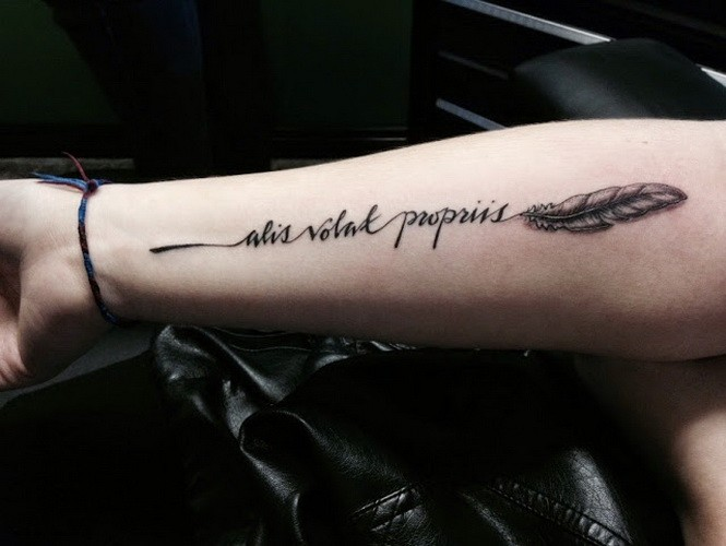 Cute little feather with quote tattoo on arm