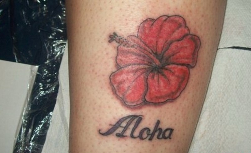 Cute red hawaiian flower with quote tattoo