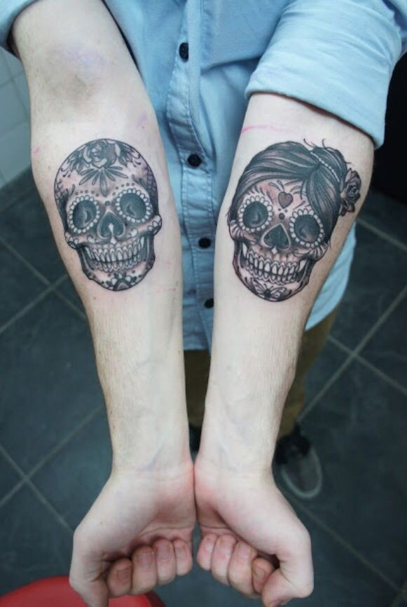 Double amuse girly muerte skull tattoo on forearms