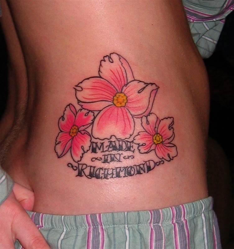 Elegant colorful hawaiian flowers with quote tattoo on side