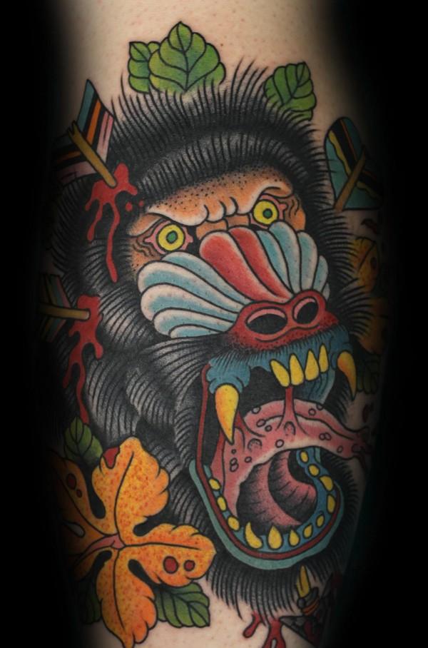 Evil crying baboon tattoo on leg