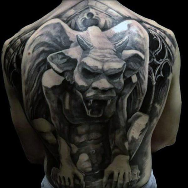 Gray washed style large whole back tattoo of stone gargoyle statue