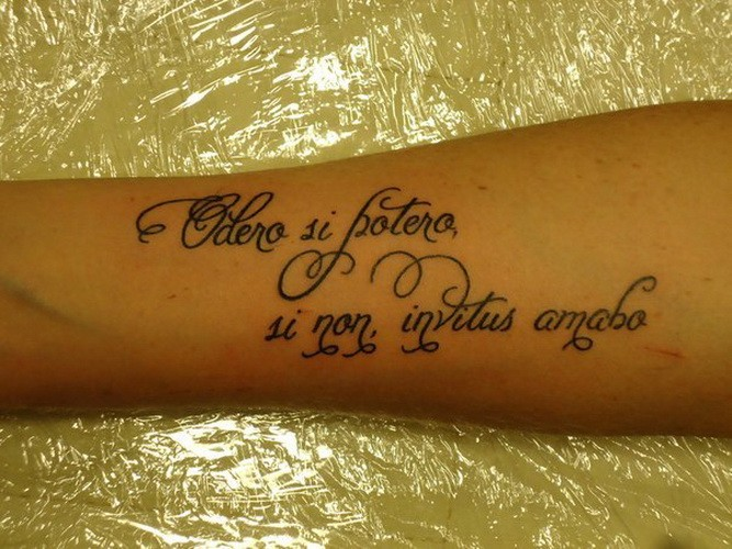 Great curly-lettered quote tattoo on arm