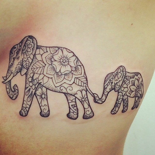Great ornamented elephant family tattoo for girls on rib-side