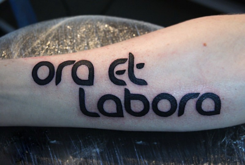 Harsh ora et labora quote tattoo for men on arm