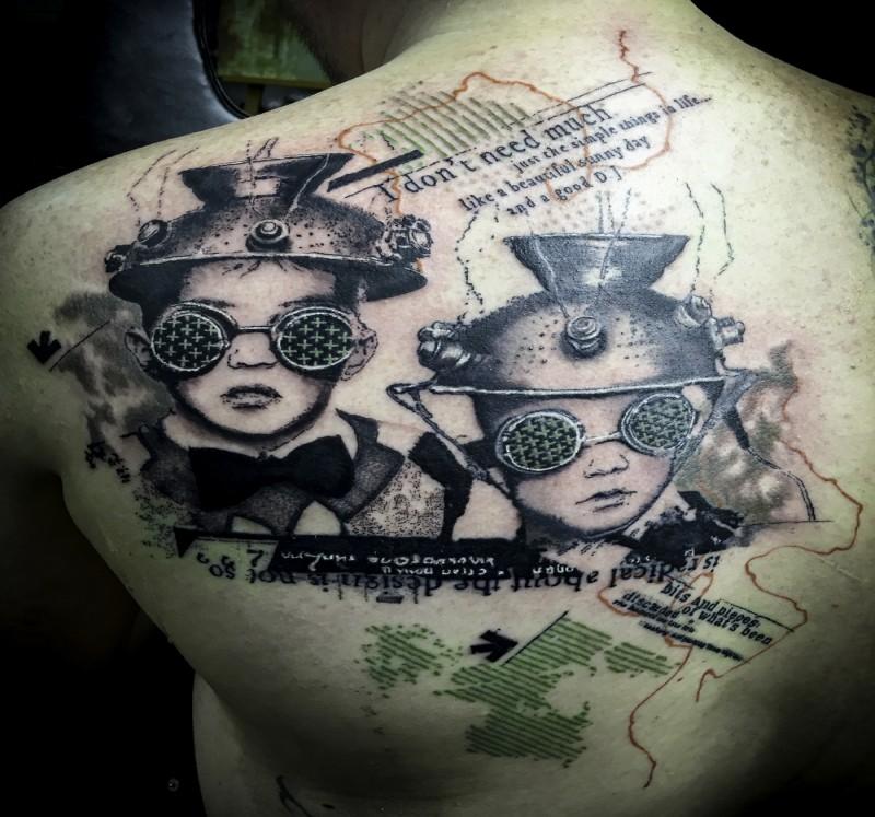 Identical black ink upper back tattoo of strange boys with lettering