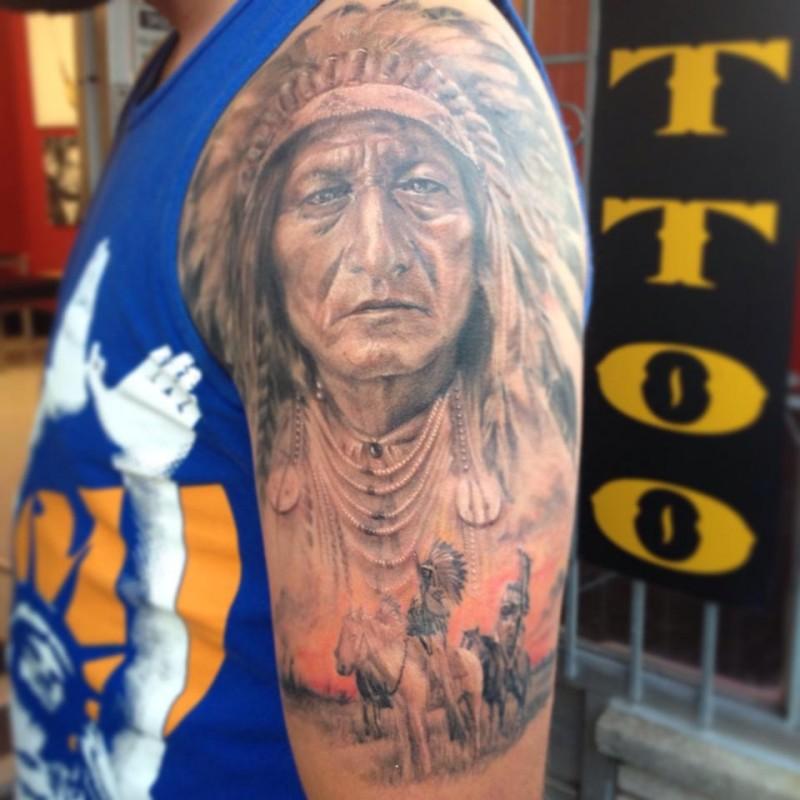 Indian warriors on horseback tattoo on shoulder