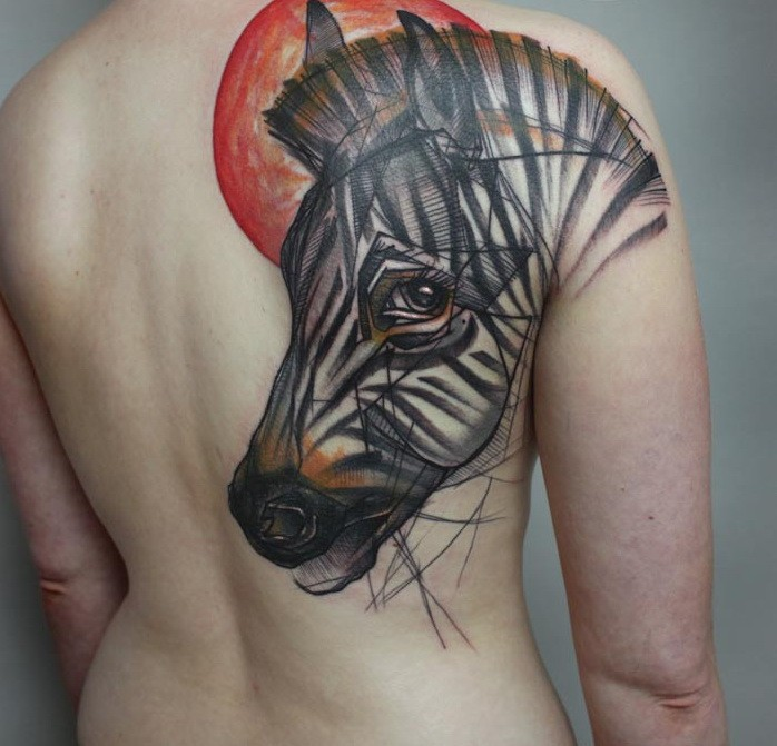 Interesting-designed color-ink zebra head and red sun tattoo on upper back