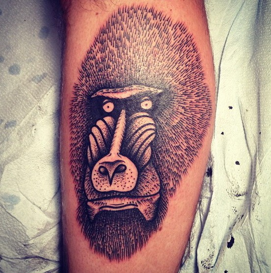 Interesting black-and-white baboon head tattoo on arm