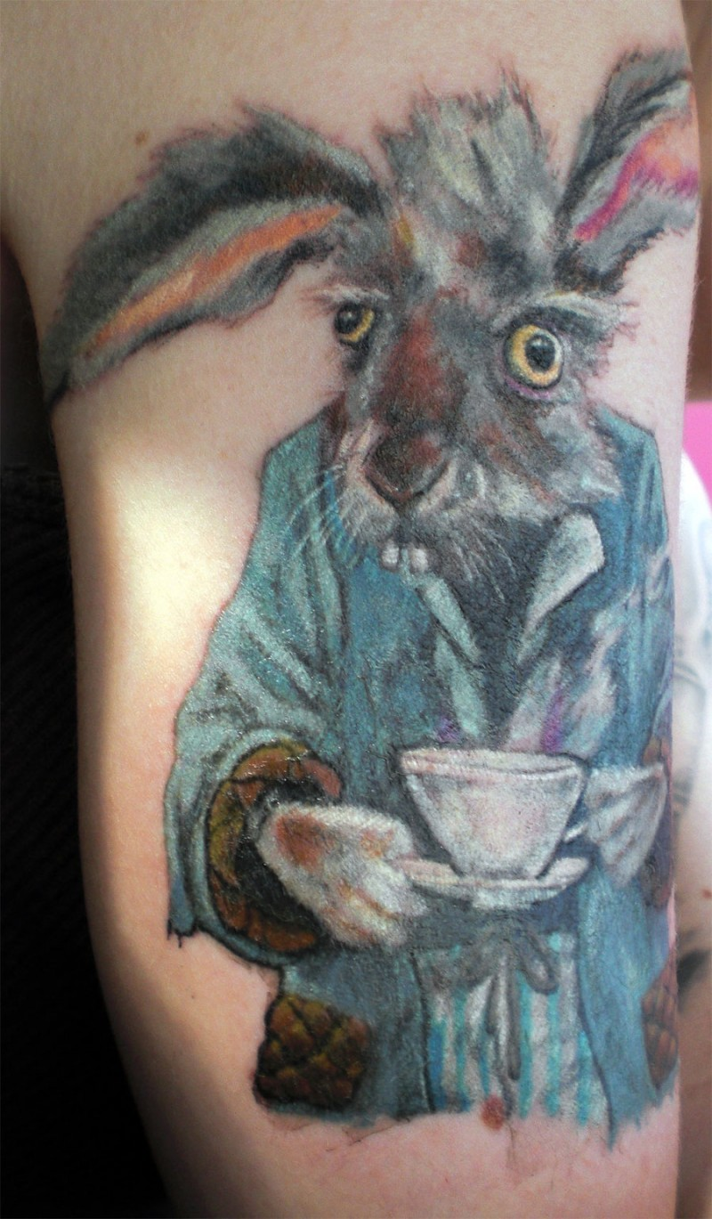 Large color-ink March hare tattoo on upper arm