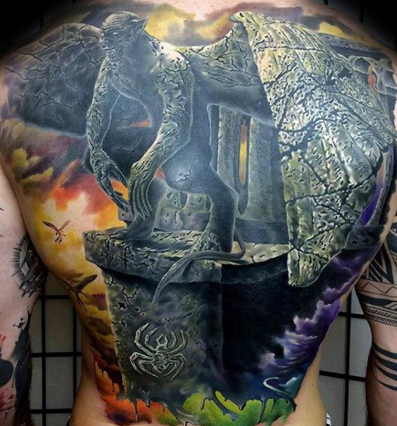 Large detailed painted whole back tattoo of gargoyle warrior statue