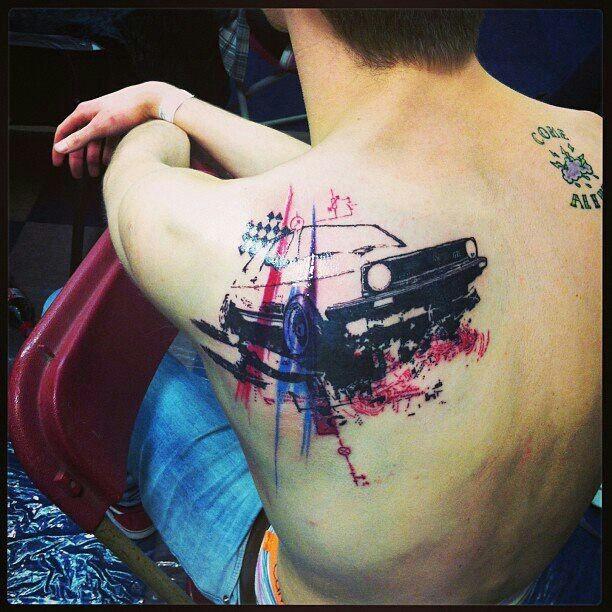 Modern trash polka style scapular tattoo of VW GTI car and flag