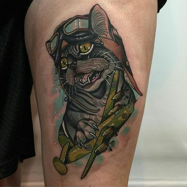 New school style colored tattoo of cat pilot with bomber plane