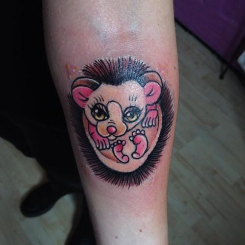 Nice girly pink hedgehog tattoo on arm