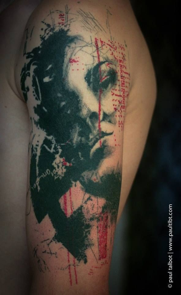Old looking colored upper arm tattoo of sad woman portrait and lettering