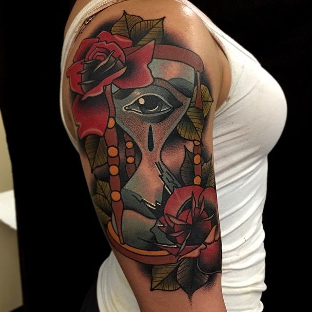 Old school hourglass with eyes tattoo on shoulder