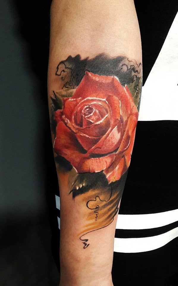 Realistic girly red rose flower tattoo on forearm