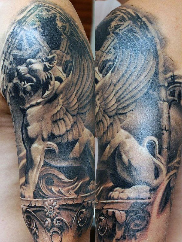 Realstic looking upper arm tattoo of stone lion with wings