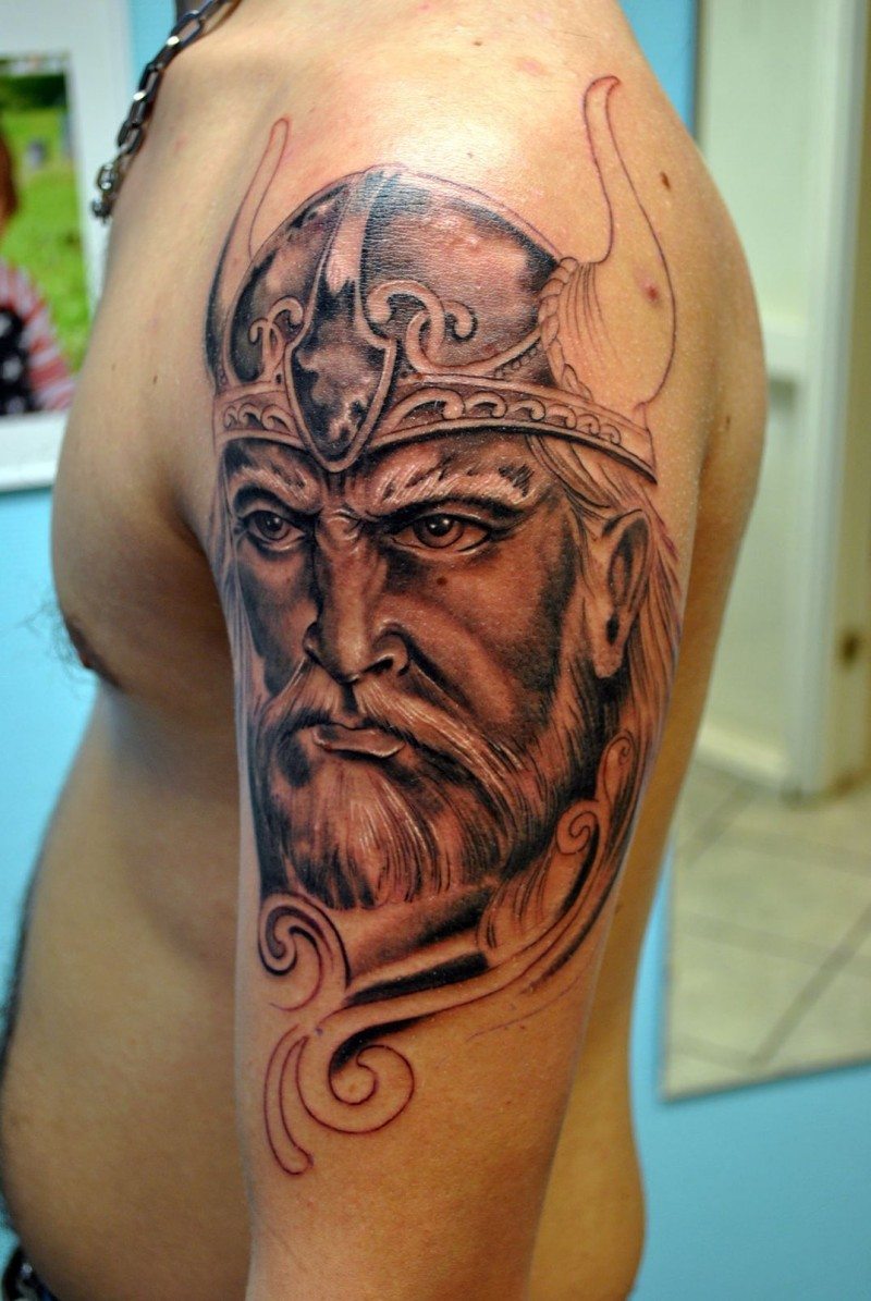Severe Viking warrior tattoo on shoulder