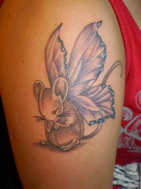 Small cute girly rodent with butterfly wings tattoo on upper arm