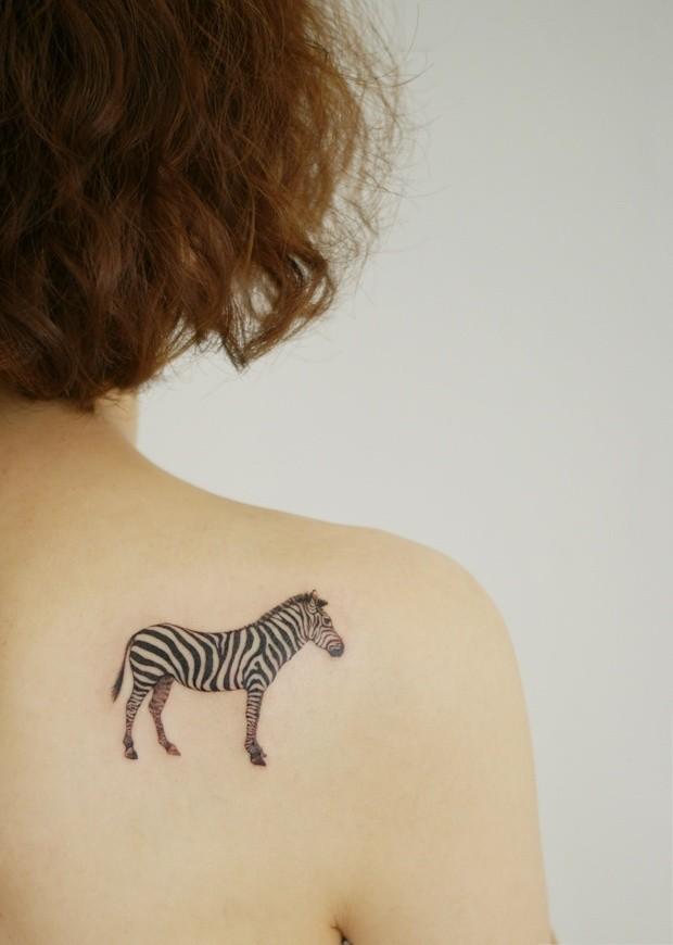 Small lovely sebra tattoo on back
