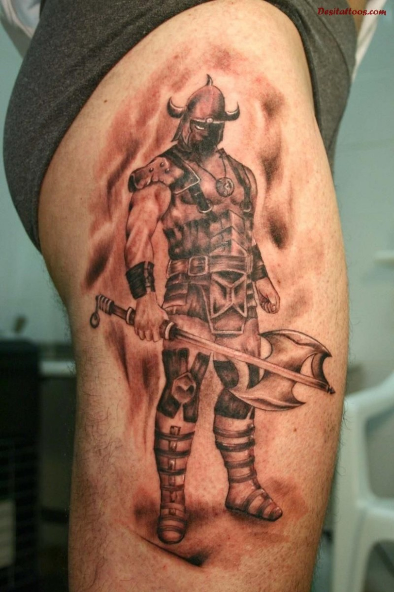 Standing brave Viking warrior with an axe tattoo on thigh