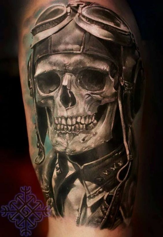Stunning realistic painted thigh tattoo of old pilot skull with helmet