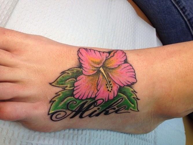 Tender purple hawaiian hibiscus flower tattoo on foot