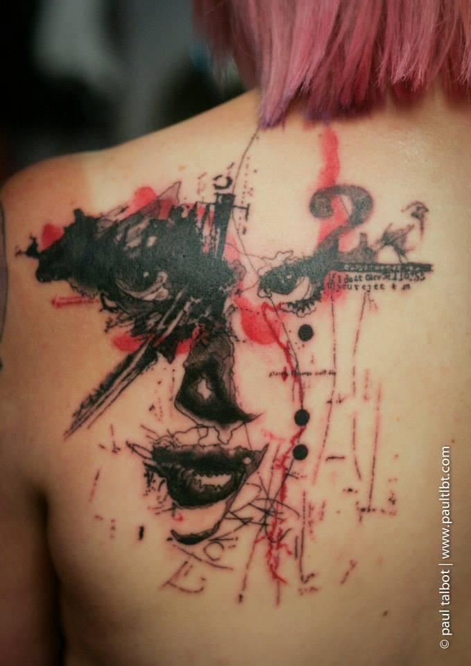 Trash polka style colored upper back tattoo of woman eyes