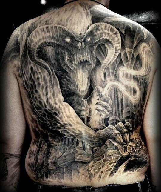 Unbeliveable whole back tattoo of Lord of the Rings monster