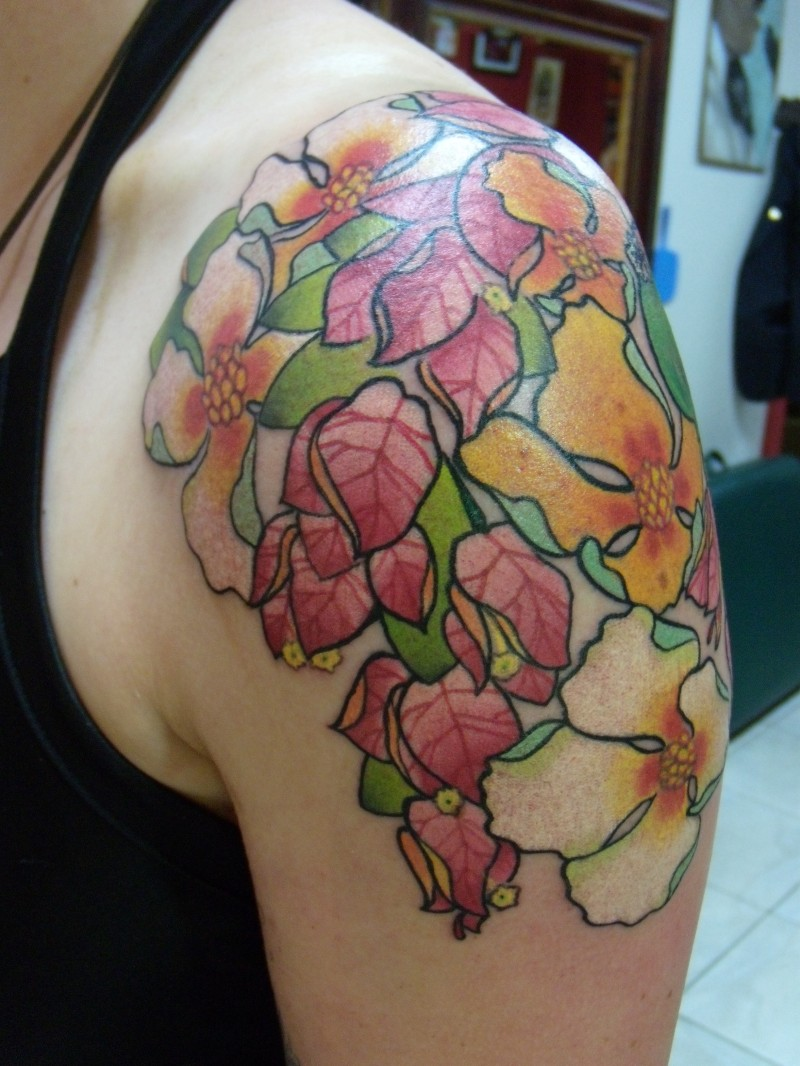Unusual colorful flower tattoo for men on shoulder