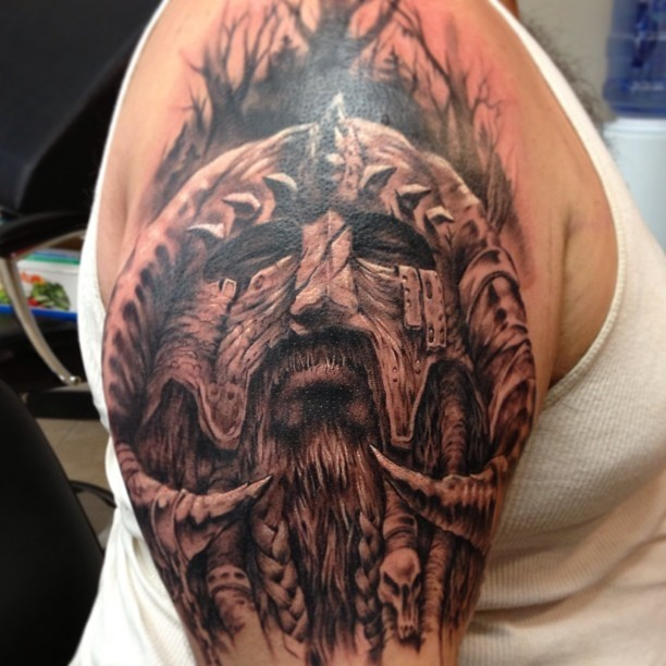 Viking warrior head tattoo on shoulder