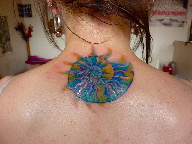 Watercolor style medium size upper back tattoo of fantasy nautilus