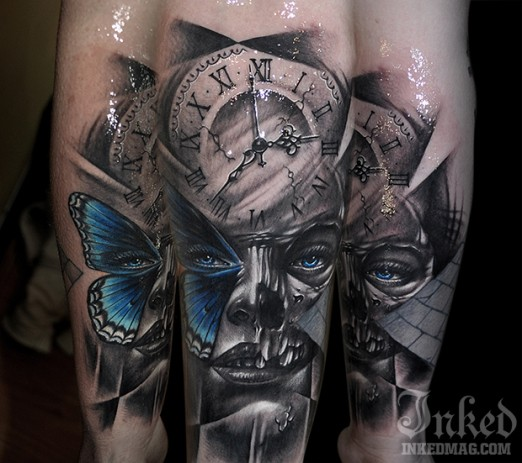 Abstract style colored arm tattoo of woman face with clock and butterfly wing